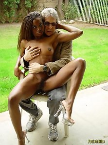 Sexy ebony babe strips and poses outdoors