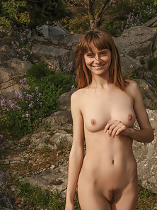Sexy Brown Haired Babe Shows Off Her Boobs at Outdoor