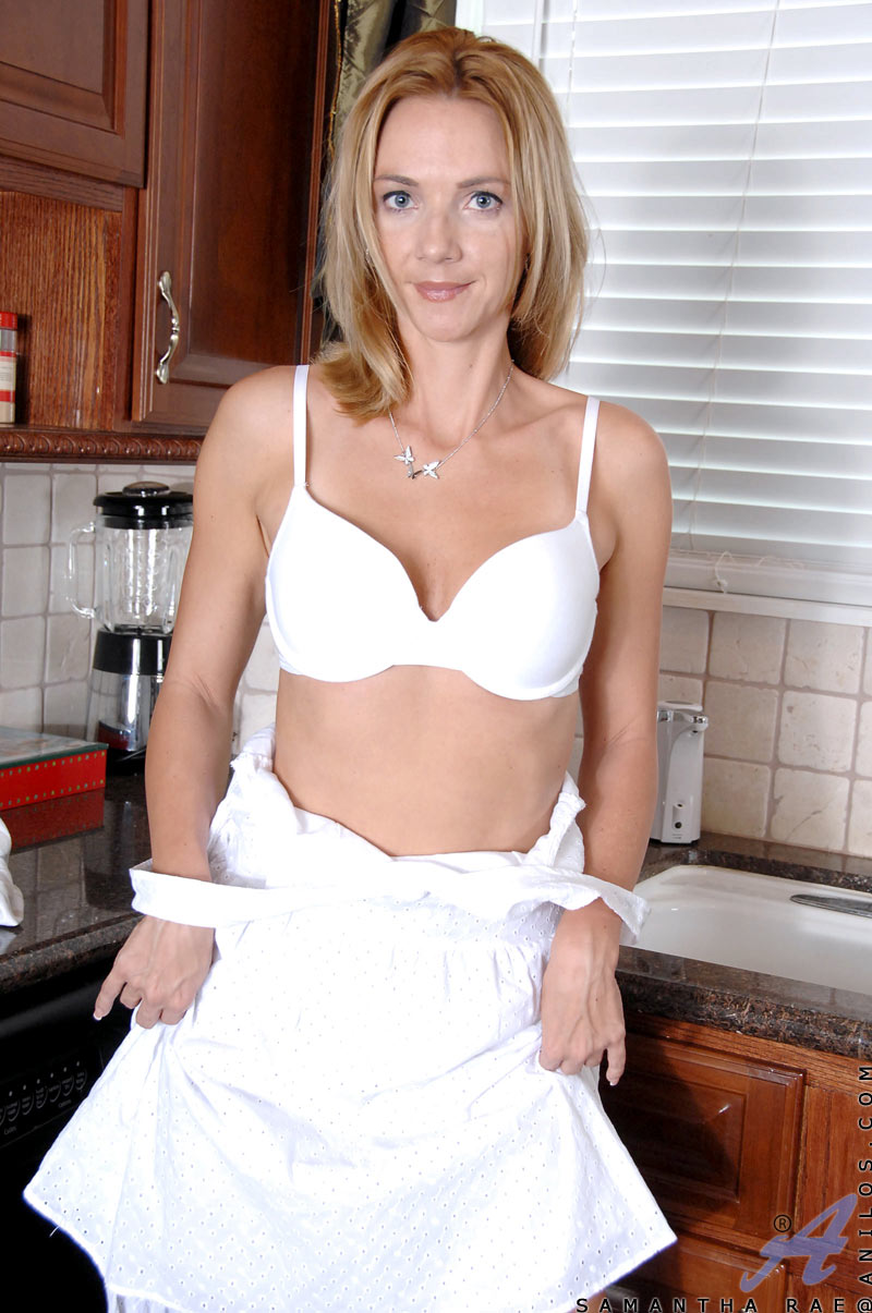 hot mature housewife slowly slips off her dress as she