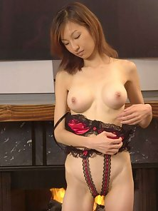 Asian with large breasts shows her tight cunt