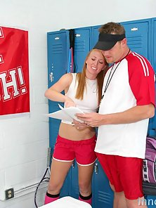Sexy redhead schoolgirl takes a cock in the locker room from her coach