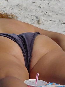 Candid babes sun tanning on the beach