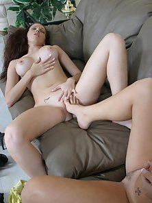 Horny lesbian hotties pushing toes in pussy