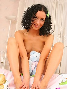 Curly Kelly embraces a teddy bear and dreams of a huge erected dick for her hungry pussy.