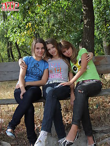 Three very hot teen lesbi girls take off their sexy clothes and pose right on the street.