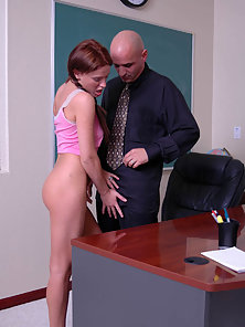 Sweet little redhead wraps her lips around professors hard dick