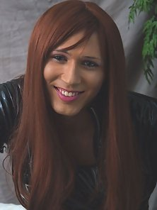 Redhead tranny in a vinyl dress and boots