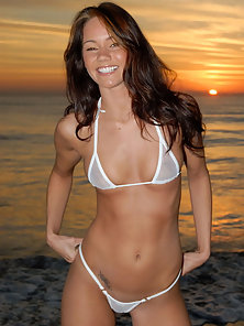 Lacy poses in a skimpy white bikini