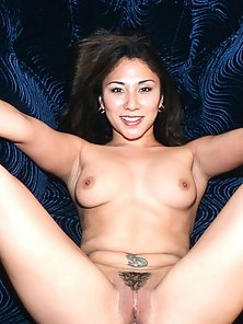 Asian with big boobs spreads her shaved pussy
