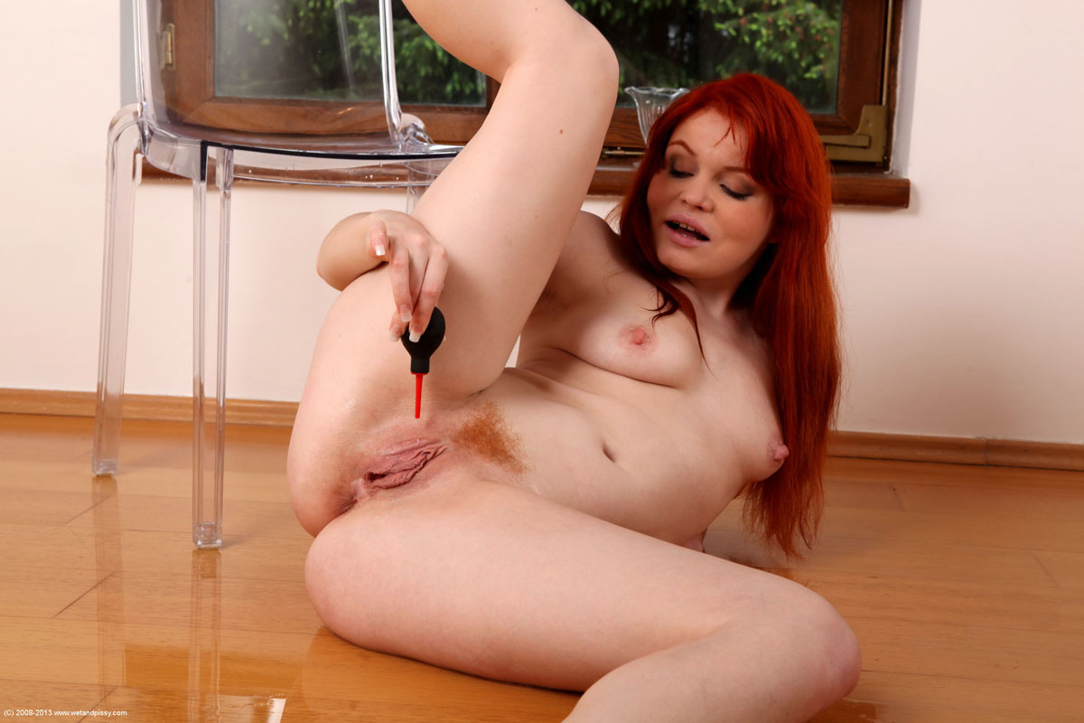 Wet red haired pussy