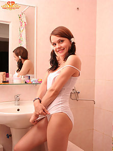 She have a passion for posing nude, this time she decided to undress in the bathroom - admire her fr