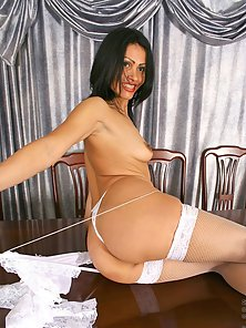 Exotic milf nelli portrays her flexibility by lifting her long legs above her head, giving a mouth w