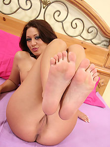 Redhead slut plays with her toes before a load is dropped on them after a fuck