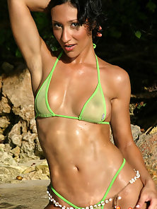 Sweet looking brunette in a sheer lime green bikini