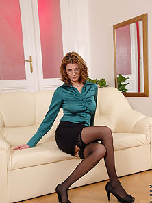 Seductive business woman teases us with her enticing milf body in a tight top and short skirt