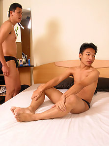 Threesome action as two sexy asian twinks do their friend