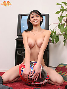 Teen biker-girl has left her bike in a garage and wishes to have fun, she undresses to the skin and