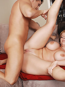 Thick milf with huge tits fucks a young stud
