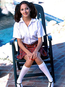 School girl Jenna Haze outside takes off her uniform