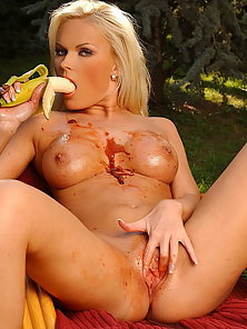 Very hot blond is playing with icecream and banana
