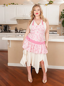 Sweet housewife gives you a peek up her dress as she bakes