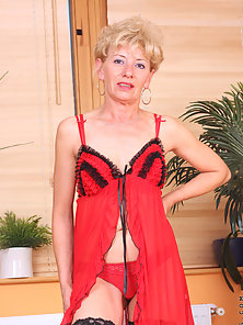 Seductive blonde milf bares her fair skinned mature body and fondles her juicy snatch for a solo org