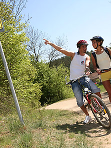 Biking teenage couple pounding during their outdoor trip