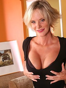 Busty milf Kara gives a young stud a hot tit job