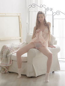 Skinny Blonde Chick Spreads Her Pink Hairy Clit in Gladness Mood On Couch