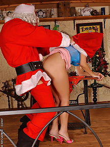 Little bad girl gets a huge cock from Santa Claus