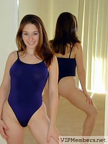 Alissia strips in front of the mirror