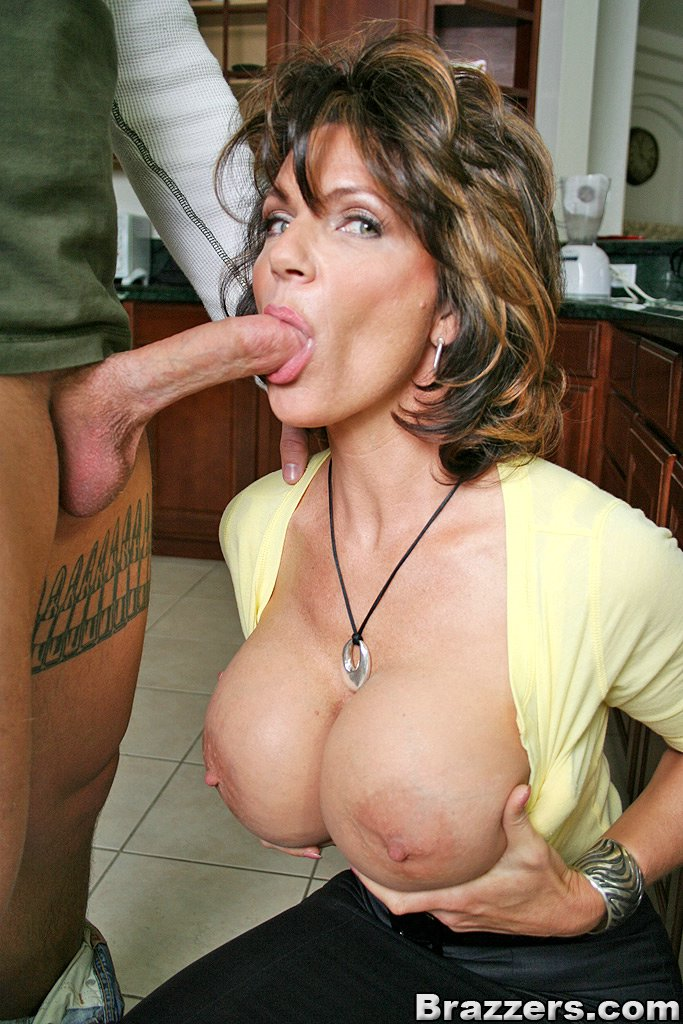 Watch two big breasted milfs sucking guys cock