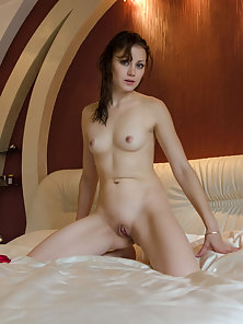 Sexy Brunette Chick with Fully Naked Body Exposing Her Boobs and Ass