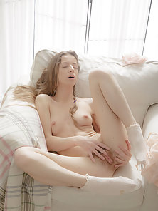 Fetching White Girl Reveals Her Nice Hairy Snatch in Spread Position