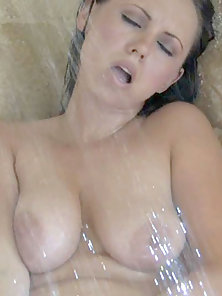 Horny brunette with huge boobs gets naughty in the shower