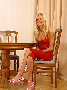Cute blonde teenie spreads on a table and fucks her narrow pink slit with a dildo.