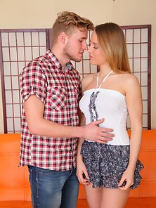 Appealing Horny Irina Gets Banged in Different Positions on Orange Couch