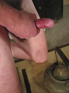 Twink gets a boner and jerks off, squeezing out a hot load of cum.