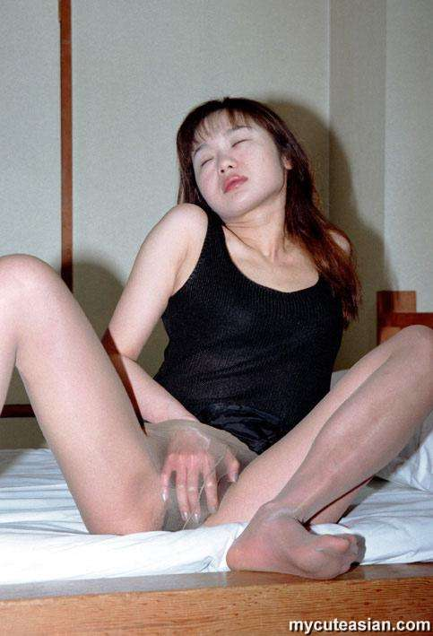 Asian mature wife using her dildo
