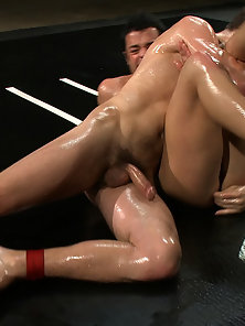 Tommy Defendi strokes his nine inch cock and fights Dan Caroggio in oil.