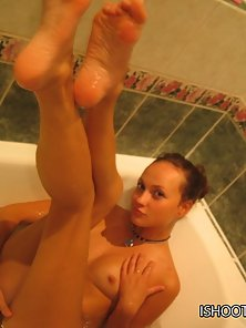 Tanya gets very aroused and playful in a hot tub and starts touching and rubbing her tits, belly and