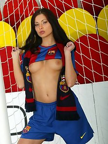 Evelyn Lory as a sexy stripping soccer player