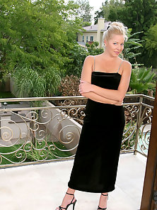Seductive blonde cougar jacy andrews lifts her black velvet gown exposing a beautiful ass