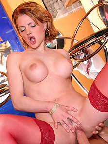 Dirty redhead with red stockings fucked in her tight ass