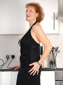 Fine mature lady in elegant evening wear will rock your cock