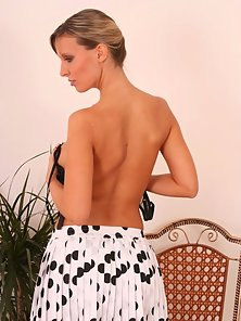 Hot blonde with a pony tail shows of her huge breasts and nice ass