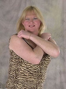 A chubby blonde tranny posing in the nude