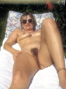 Yvonne outside naked with hairy pussy