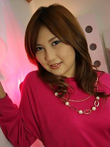Japanese babe Hiyori Konno in pink shows off her soft tiny pussy