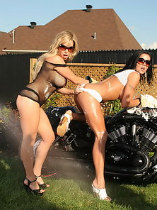 Two hot babes with huge tits riding on a bike